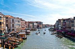 Traffic in Venice. Panoramic view of famous Grand Canal, Also visible are various local transport, restaurants, coffee shops and Venetian traditional Royalty Free Stock Image