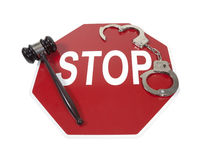 Traffic Violations. Shown by a stop sign with handcuffs and a gavel - path included royalty free stock photo