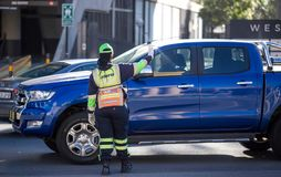 Traffic warden in traffic. royalty free stock images