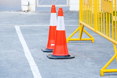 Traffic warning cone in row to separate route in parking area. View of a Vehicle Security Barrier stock photography