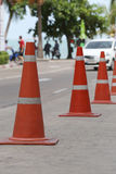 Traffic warning cone in row to separate route. Traffic warning cone in row to separate route in walkway for pedestrians stock photography
