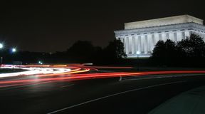 Traffic through Washington DC. With Lincoln Memorial in the background Stock Photography