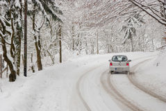 Traffic On A Winter Day. Driving with bad weather conditions: road is covered by snow Royalty Free Stock Photography