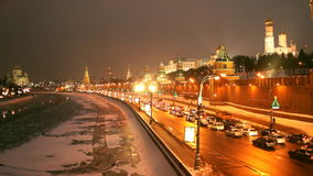 Traffic in winter Moscow, Russia. Moscow, Russia - January 16, 2013: Traffic on the embankment of Moscow river under the Kremlin wall in a winter evening. Moscow stock footage