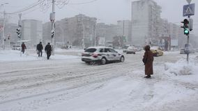 Traffic winter. Traffic slowed by snow - snow fall stock video footage
