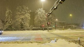 Traffic during winter snow storm. Traffic in the city, scoreboard, the snow falls stock video