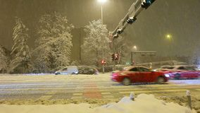 Traffic during winter snow storm. Traffic in the city, scoreboard, the snow falls stock footage