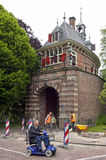 Traffic and workers for ancient city gate of Hoorn Royalty Free Stock Photo