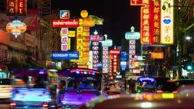 Traffic on Yaowarat Road at night, Chinatown, Bangkok, Thailand stock footage