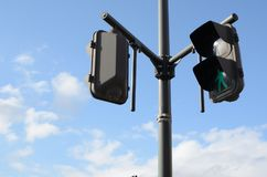 Go forward. A trafficlight tells you to go forward. The sunny weather also gives you a positive atmosphere Stock Image