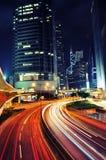 Traffico occupato alla notte Fotografie Stock