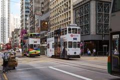 Traffico sulla strada del DES Voeux in Hong Kong Immagini Stock Libere da Diritti
