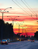 Trafic on highway at sunset Royalty Free Stock Photography