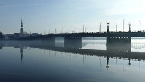 Trafic on Stone Bridge near Riga old town. Seen over foggy river Daugava stock video footage