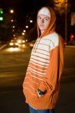 Traficante joven en la noche Fotografía de archivo
