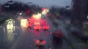 Traficc on the road, top view from wet window. Slow motion video stock video