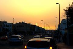 Trafik & solnedgång Arkivfoto