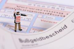 Trafikbiljett från den tyska polisen Royaltyfria Foton