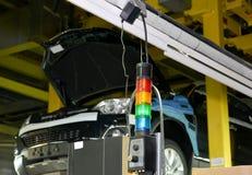 Trafikljuset för reglering av arbete av transportörlinjen av Royaltyfria Bilder
