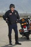 Trafiksnut med motorcykeln Arkivfoton