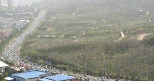 trafikstockningar för stads- stad för porslin 4k upptagna, affärsbyggnad, luftförorening arkivfilmer