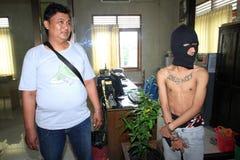 Trafiquant de drogue arrêté par police Image libre de droits
