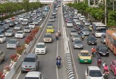 Trafique na estrada, Banguecoque, Tailândia Imagem de Stock