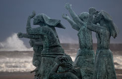 Tragedy at sea, the widows. Matosinhos, Portugal - August 1, 2015: Sculptural ensemble by Jose Joao Brito, located in Matosinhos beach near the port of Leixoes Royalty Free Stock Photos