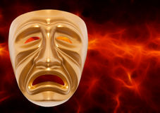 Tragedy theatrical mask. On a red background Stock Photos