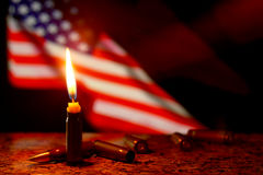 Tragedy in USA. Candles flag tragedy in USA weapons dark background Stock Photo