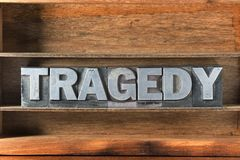 Tragedy word tray. Tragedy word made from metallic letterpress type on wooden tray Royalty Free Stock Images