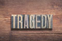 Tragedy word wood. Tragedy word combined on vintage varnished wooden surface royalty free stock image