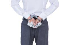 Tragen Sie Ansicht des Geschäftsmannes mit der Handschelle und Geld in den Händen Lizenzfreie Stockfotografie
