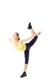 Tragen Sie Eignungsfrau, das junge gesunde Mädchen zur Schau, das Übungen tut, die lokalisierte Ganzaufnahme Stockbild