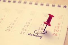 Tragen Sie ein und markierte das Datum am Feiertagsweinleseton Stockfoto