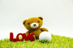 Tragen Sie und spielen Sie mit Liebesbrief auf weißem Hintergrund Golf Stockfotografie