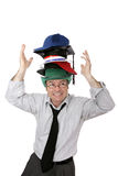Tragen zu vieler Hüte Stockfotografie