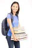 Tragende Bücher des Studenten Stockfoto