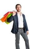 Tragende Einkaufenbeutel des Mannes Stockfotos