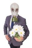 Tragende Gasmaske des Geschäftsmannes Stockbild