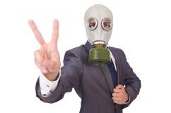 Tragende Gasmaske des Geschäftsmannes Lizenzfreies Stockfoto