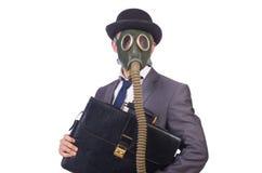Tragende Gasmaske des Geschäftsmannes Stockfotos