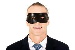 Tragende Maske des blauen Auges des Geschäftsmannes Stockbild