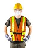Tragende Sicherheitsausrüstung des Bauarbeiters Lizenzfreie Stockfotos