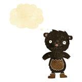 tragende Stiefel des schwarzen Bären des Karikaturteddybären mit Gedankenblase Lizenzfreie Stockbilder