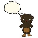 tragende Stiefel des schwarzen Bären des Karikaturteddybären mit Gedankenblase Lizenzfreie Stockfotos