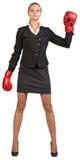 Tragende Verpackenhandschuhe der Geschäftsfrau Lizenzfreies Stockfoto