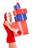 Tragender Geschenkstapel der Weihnachtsfrau Stockbild