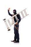 Tragender Kopfschutz des Einbrechers Stockfotos