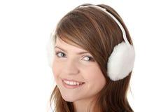 Tragender weißer Ohrenschützer des Mädchens des recht jungen jugendlich lizenzfreie stockfotos